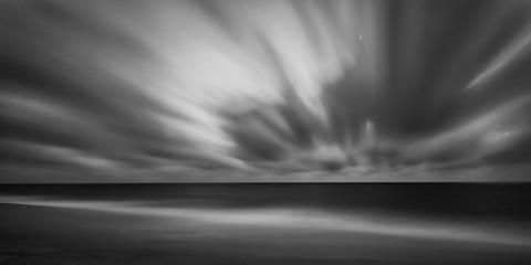 Dramatic long exposure seascape on the beach of Faro, Portugal.