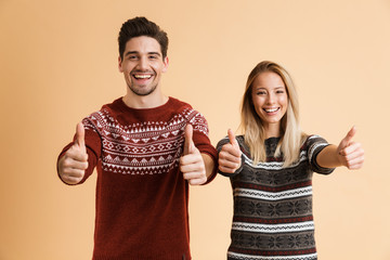 Portrait of an excited young couple dressed in sweaters