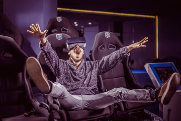 man in virtual glasses is watching a movie in 5d in a cinema