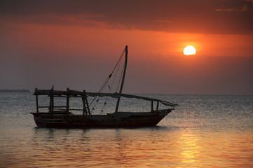 Traditional dhow boat at sunset, Zanzibar, Tanzania