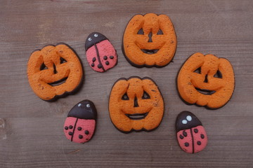 Homemade pastry cookies for Halloween in the form of pumpkins and ladybugs