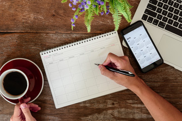 SEPTEMBER 17, 2018: Working table top with organizer for monthly planing with Iphone 8 plus use calendar application with year 2019