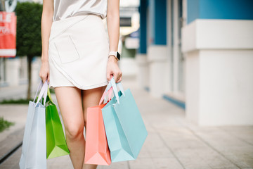 woman holding many shopping bags in fashion boutique,flare light