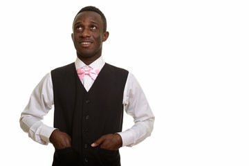 Young happy African waiter smiling and thinking