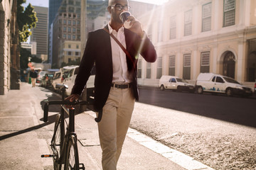 Businessman going to work by bicycle