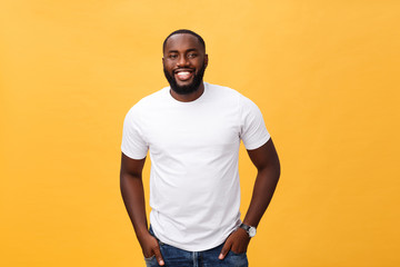 Portrait of delighted African American male with positive smile, white perfect teeth, looks happily...