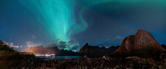 Panorama shot with Northern Lights Aurora Borealis with classic view of the fisherman s village of Hamnoy, near Reine in Norway, Lofoten islands. This shot is powered by a wonderful Northern Lights