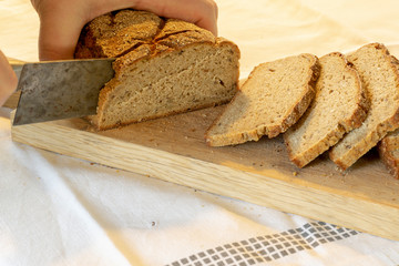 hands slicing home-made bread