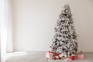 White Christmas tree in the room with gifts