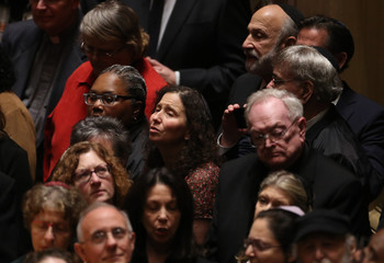 Mourners attend a memorial service at the Sailors and Soldiers Memorial Hall of the University of Pittsburgh