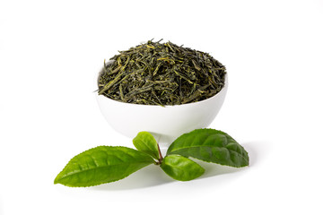 Green sencha tea in white cup with tealeaves