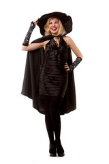 Full-length photo of happy witch blonde in black hat