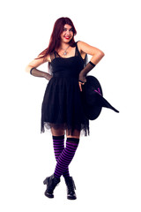 Photo of witch in black dress and hat