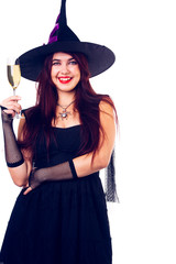 Image of happy witch with wine glass with wine in black dress and hat