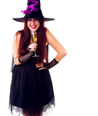 Portrait of laughing witch in black hat, with glass of champagne