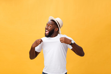 Handsome young Afro-American man employee feeling excited, gesturing actively, keeping fists clenched, exclaiming joyfully with mouth wide opened, happy with good luck or promotion at work