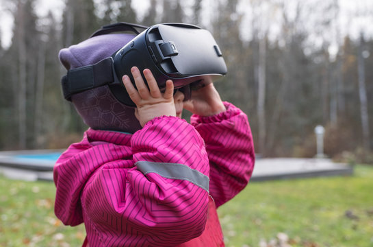 Digital technology virtual reality glasses 3d. Child plays in sertraline reality.  child,