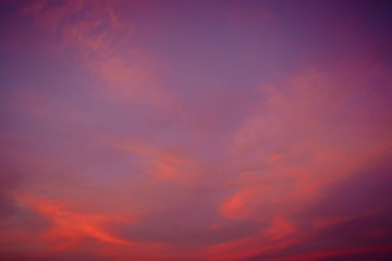 Clouds of beautiful color in the fall. Sunset pink red orange color.