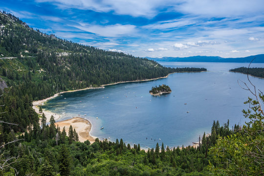 Emerald Bay view with Fannette Island in South Lake Tahoe California in the Sierra Nevada mountains. Sunshine in the summer, boats on the water