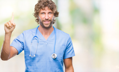 Handsome hispanic surgeon doctor man over isolated background showing and pointing up with finger number one while smiling confident and happy.