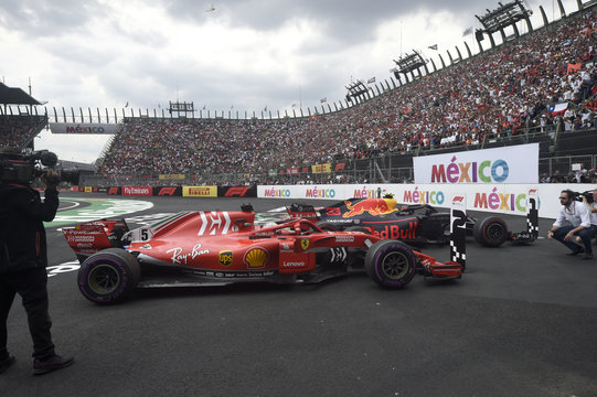 Red Bull's Dutch driver Max Verstappen and Ferrari's German driver Sebastian Vettel cars are pictured after winning the first and the second place, respectively, in the F1 Mexico Grand Prix at the Hermanos Rodriguez circuit in Mexico City