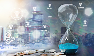 Double exposure of hourglass with coins for time of finance concept