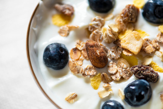 Bowl of yogurt with blueberries and granola