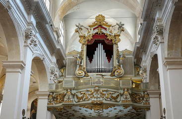 Pipe organ of the Franciscan Church and Monastery in Dubrovnik, Croatia with the resurrected Christ statue created by the sculptor Celia from Ancona in 1713.