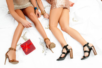 Beautiful women in glamorous dresses napping in her bed after party.