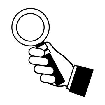 hand holding magnifying glass social media