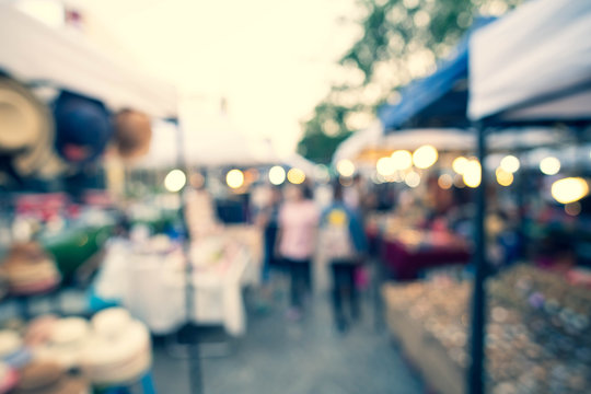 Abstract Blurred image of Day Festival or Flea market with light bokeh for background usage.