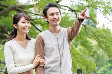 young asian couple in park