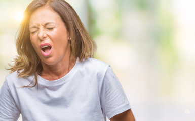 Middle age senior hispanic woman over isolated background with hand on stomach because indigestion, painful illness feeling unwell. Ache concept.