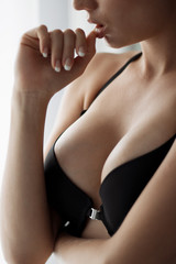 Young beautiful girl with magnificent breasts chic