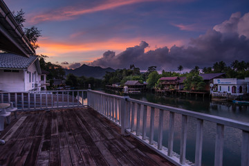 Sunrise stilts reflect in the river at klong prao district on koh chang,