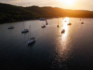Wall Mural - Aerial view of harbor with sailing yachts at the Sea during amazing sunset.