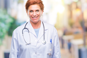 Senior caucasian doctor woman wearing medical uniform over isolated background with a happy and cool smile on face. Lucky person.