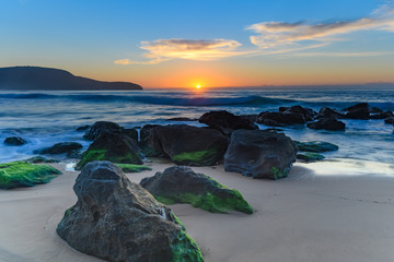 Sun, Sand, Sea and Rocky Sunrise