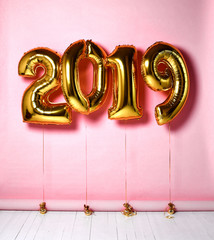 2019 Christmas inflatable gold numbers balloons on pink background for new year