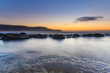 Sun, Sand, Sea and Rocky Sunrise