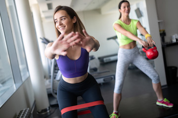 Attractive young women working out at a gym.
