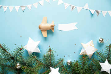 Children's wooden plane in the sky carries an empty banner.