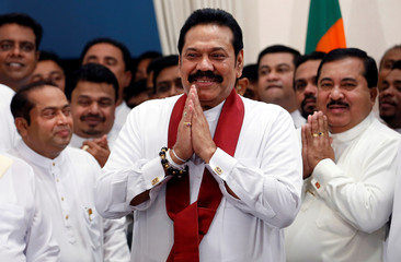 Sri Lanka's newly appointed Prime Minister Rajapaksa gestures during the ceremony to assume duties at the Prime Minister office in Colombo