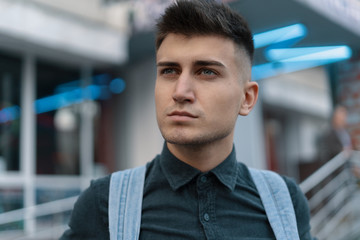 Portrait young man on blurred city background