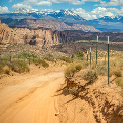 Off road trail with cliffs and La Sal Mountain