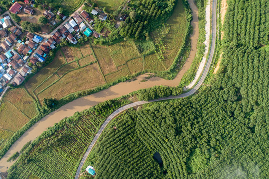 Aerial view country village with mountain and mist fog during morning time in asia thailand