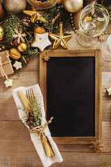 Christmas or New Year table setting.  Menu blackboard frame   for  Christmas Dinner. Holiday Decorations.