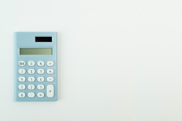 blue calculator white background  image close up.