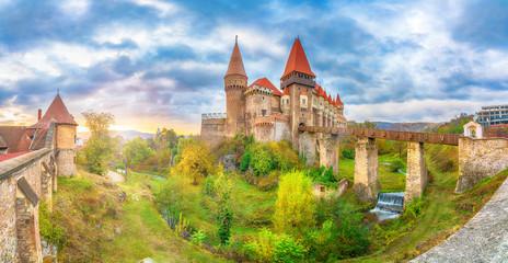 Wall Mural - Beautiful Hunyad Corvin medieval castle in the sunset light, Hunedoara town,Transylvania landamark, Romania,Europe