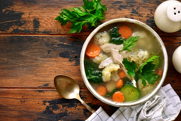 Vegetable soup with chicken fillet.Top view with copy space.